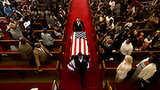 CHARLESTON, SC - JUNE 30, 2015: Staff members of Leevy's Funeral Home carry the flag draped casket of Rev. Daniel Lee Simmons Sr. out of the Greater St. Luke A.M.E Church following a service, Tuesday June 30, 2015, in Charleston, S.C.  Simmons was among nine people killed in the shooting in Charleston on June 17. CREDIT: Stephen B. Morton for The New York Times
