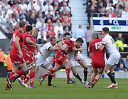 Twickenham Great Britain. Scrum Half, Rhys WEBB's run is held by left Chris ROBSHAW and Tom WOOD during the 2014 RBS Six Nations Rugby; England vs Wales, at the RFU Stadium, Twickenham, England.   [Mandatory Credit; Peter Spurrier/Intersport-images]