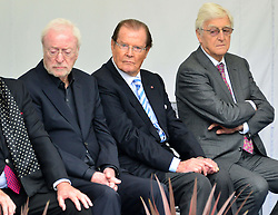 Michael Winner public memorial.  <br /> (L-R) Sir Michael Caine, Sir Roger Moore, Sir Michael Parkinson during the Memorial.<br /> Memorial takes place at the National Police Memorial. The film director and food critic helped establish, following his death on January 23 2013. <br /> Geraldine Winner, Sir Michael Parkinson, Sir Michael Caine, Sir Roger Moore, Cilla Black, Carol Vorderman, Sir Terence Conran, give eulogies, <br /> London, United Kingdom<br /> Sunday, 23rd June 2013<br /> Picture by Nils Jorgensen / i-Images