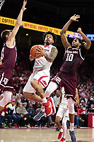 FAYETTEVILLE, AR - FEBRUARY 17:  Anton Beard #31 of the Arkansas Razorbacks drives to the basket against Chris Collins #12 and Tonny Trocha-Morelos #10 of the Texas A&M Aggies at Bud Walton Arena on February 17, 2018 in Fayetteville, Arkansas.  The Razorbacks defeated the Aggies 94-75.(Photo by Wesley Hitt/Getty Images) *** Local Caption *** Anton Beard; Chris Collins; Tonny Trocha-Morelos