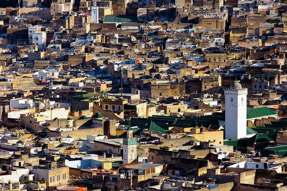 FEZ, MOROCCO - 3RD FEBRUARY 2018 - View over the old Fez Medina, with the Al-Karaouine Mosque and University (building on the left with green tiled roof and white Minaret) and the Zawiya Moulay Idriss II (larger building on the right with pyramid roof).<br /> <br /> Established at the very beginnings of Morocco's oldest imperial city, the University of Al-Karaouine (also written as Al-Quaraouiyine and Al-Qarawiyyin) was founded in 859 and is considered by Unesco and the Guinness Book of World Records to be the oldest continually operating university in the world.