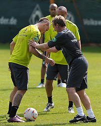 06.05.2011, Trainingsgelaende Werder Bremen, Bremen, GER, 1.FBL, Training Werder Bremen, im Bild Marko Arnautovic (Bremen #7, links), Matthias Hönerbach / Hoenerbach (Co-Trainer Werder Bremen, rechts)   EXPA Pictures © 2011, PhotoCredit: EXPA/ nph/  Frisch       ****** out of GER / SWE / CRO  / BEL ******