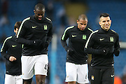 Sergio Agüero of Manchester City, Yaya Touré of Manchester City and Fernando of Manchester City warm up before the Champions League round of 16 match between Manchester City and Dynamo Kiev at the Etihad Stadium, Manchester, England on 15 March 2016. Photo by Simon Brady.