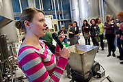 Organizer Robyn Klinge details different types of malts during Women's Brew Day at Wisconsin Brewing Company in Verona, Saturday, January 24, 2015. The day was filled with education for female brewers from female beer industry experts, discussing malt, hops, beer styles and beer distribution.