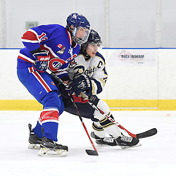 TORONTO, ON - Nov 29, 2015 : Ontario Junior Hockey League game action between Toronto Patriots and Toronto Jr. Canadiens, Andrew Mullen #10 of the Toronto Jr. Canadiens battles for control with Michael Siddall #12 of the Toronto Patriots during the second period.<br /> (Photo by Andy Corneau / OJHL Images)