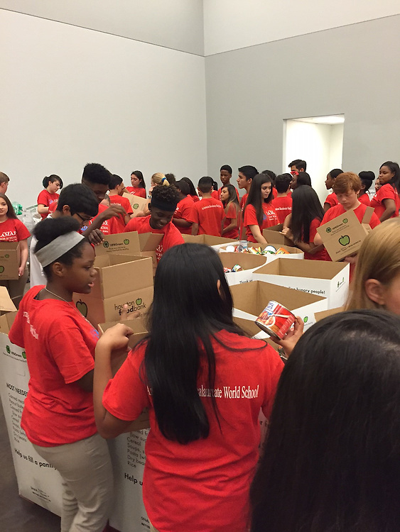 Lamara High School Summer Academy students volunteer at the Houston Food Bank.