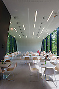 Table and chairs in cafe in building designed by architect Zaha Hadid at Ordrupgaard Art Design Architecture Museum in Denmark