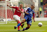 Photo: Leigh Quinnell.<br /> Nottingham Forest v Carlisle United. Coca Cola League 1. 16/09/2006. Forests Sammy Clingan clashes with Carlisles Karl Hawley.