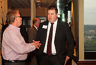 Craig Randall of tw telecom (left) and Tom Fryman of Clark, Schaefer, Hackett & Company during the Dayton Area Chamber of Commerce Breakfast Briefing at the Dayton Racquet Club in downtown Dayton, Friday, July 13, 2012.