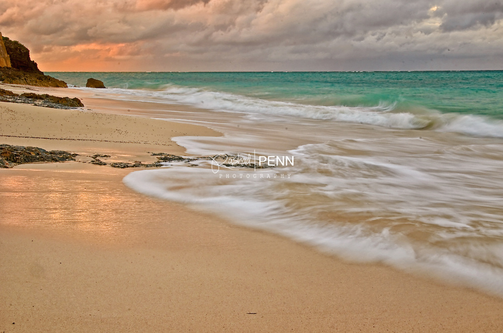 This Image captures the golden color of the Bahamian sunset as it skims on the wet sandy beaches of the island all while sudsy waves slowly roll over the colored sand enveloping it with fresh warm Caribbean salt water.  This print is available in various sizes as a print alone, a print encased in white matting or completely framed for your simplification. The color tones will match great with earth tones of your home, business or office area and will bring a subtle calmness within any room.