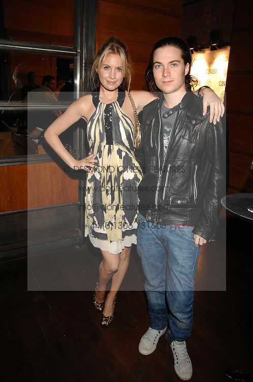 MARISSA MONTGOMERY and her brother MAX MONTGOMERY at a party to celebrate the launch of Cavalli Selection - the first ever wine from Casa Cavalli, held at 17 Berkeley Street, London W1 on 29th May 2008.<br />