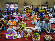 14 JANUARY 2016 - CHACHOENGSAO, CHACHOENGSAO, THAILAND: People with offerings of cooked eggs at Wat Sothon. Wat Sothon, in Chachoengsao, is one of the largest Buddhist temples in Thailand. Thousands of people come to the temple every day to pray for good luck, they make merit by donating cooked eggs and cash to the temple. The temple dates from the Ayutthaya period (circa 18th century CE).         PHOTO BY JACK KURTZ