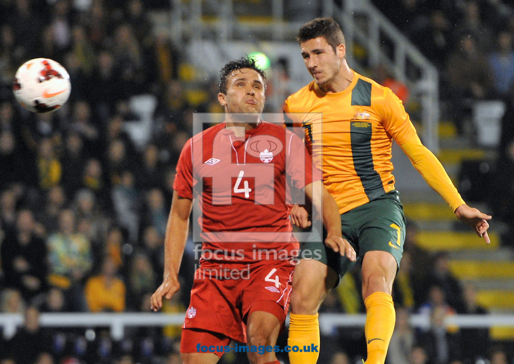 Picture by Alan Stanford/Focus Images Ltd +44 7915 056117<br />15/10/2013<br />Mathew Leckie of Australia beats Adam Straith of Canada to the header to score Australias third goal during the International Friendly match at Craven Cottage, London.