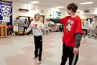 "Teghan Kelly as Hope Harcourt and Timothy Johnson as stowaway Billy Crocker sing and dance to ""You'd Be So Easy to Love"" during rehearsal for ""Anything Goes"" opening this weekend at the Inter Lakes High School auditorium.  (Karen Bobotas/for the Laconia Daily Sun)"