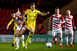 Gavin Reilly of Bristol Rovers takes on Tommy Rowe of Doncaster Rovers - Mandatory by-line: Robbie Stephenson/JMP - 26/03/2019 - FOOTBALL - Keepmoat Stadium - Doncaster, England - Doncaster Rovers v Bristol Rovers - Sky Bet League One