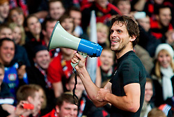 """23.11.2011, BayArena, Leverkusen, Germany, UEFA CL, Gruppe E, Bayer 04 Leverkusen (GER) vs Chelsea FC (ENG), im Bild Bayer Leverkusen's match-winning goalscorer Manuel Friedrich leads his side's """"Ultra"""" supporters in celebratory chanting after the 2-1 victory over Chelsea in the football match of UEFA Champions league, group E, between Bayer Leverkusen (GER) and FC Chelsea (ENG) at BayArena, Leverkusen, Germany on 2011/11/23. EXPA Pictures © 2011, PhotoCredit: EXPA/ Sportida/ David Tickle..***** ATTENTION - OUT OF ENG, GBR, UK *****"""