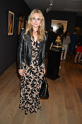 LAURA COLEMAN at a private view of photographs in aid of the Sir Hubert von Herkomer Arts Foundation held at Alon Fine Art, 5-7 Dover Street, London on 8th September 2015.