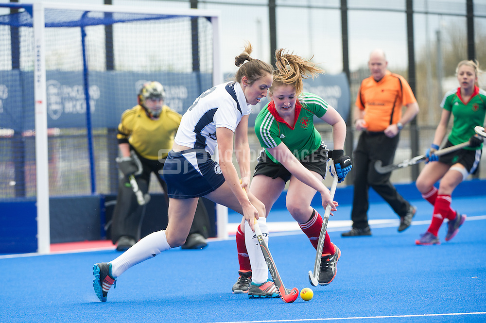 East Grinstead's Heather Brown is challenged by Alice Handy of Wakefield. East Grinstead v Wakefield - Investec Women's Hockey League Finals Weekend, Lee Valley Hockey & Tennis Centre, London, UK on 19 April 2015. Photo: Simon Parker