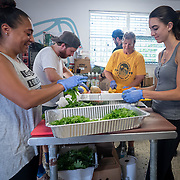 JULY 20, 2018---HATO REY, PUERTO RICO----<br /> Volunteers preparing food to be delivered during the day as part of the World Central Kitchen initiative in Puerto Rico which came to prominence following the aftermath of the devastation left by Hurricane Maria in Puerto Rico. <br /> (Photo by Angel Valentin/Freelance)
