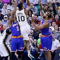 09 December 2015: Utah Jazz guard Alec Burks (10) goes for the jump shot over New York Knicks guard Langston Galloway (2) and New York Knicks forward Derrick Williams (23) during the Utah Jazz 106-85 victory over the New York Knicks, at the Vivint Smart Home Arena, Salt Lake City, Utah, USA.