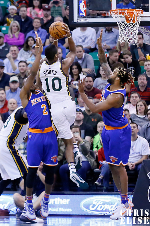 09 December 2015: Utah Jazz guard Alec Burks (10) goes for the jump shot over New York Knicks guard Langston Galloway (2) and New York Knicks forward Derrick Williams (23) during the Utah Jazz 106-85 victory over the New York Knicks, at the Vivint Smart Home Arena, Salt Lake City, Utah, USA.