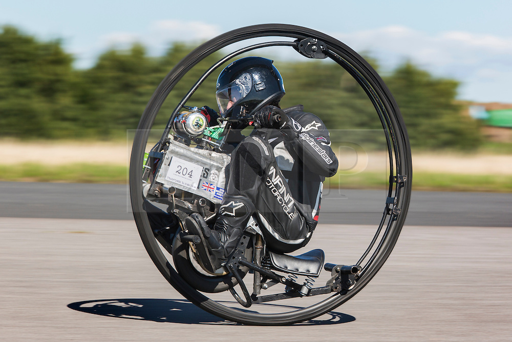 © Licensed to London News Pictures. 19/09/2015. York, UK. Picture shows Kevin Scott & his mono wheel at the  Starightliners speed weekend has taken place at Elvington Airfield near York today were a motorised shed, Jet car & motorbikes attempt new British speed records. Photo credit: Andrew McCaren/LNP