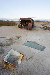 Rusted van buried in sand, Bombay Beach, Salton Sea, California