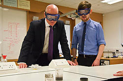 Pictured: John Swinney and Philip Wooton check an experiment<br /> <br /> Deputy First Minister and Education Secretary John Swinney visited St Augiustine's RC High School in Edinburgh to speak to young people about attainment and leaving schools with the suite of statistics published today. St Augustine's RC High School<br /> <br /> <br /> Ger Harley | EEm 19 June 2018