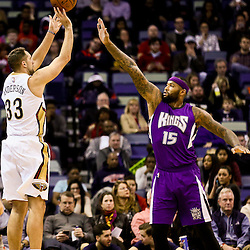 Jan 28, 2016; New Orleans, LA, USA; New Orleans Pelicans forward Ryan Anderson (33) shoots over Sacramento Kings center DeMarcus Cousins (15) during the first quarter of a game at the Smoothie King Center. Mandatory Credit: Derick E. Hingle-USA TODAY Sports