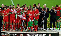 CARDIFF, WALES - Tuesday, October 13, 2015: Wales' Aaron Ramsey and Gareth Bale celebrate after qualifying for the finals following a 2-0 victory over Andorra during the UEFA Euro 2016 qualifying Group B match at the Cardiff City Stadium. Ben Davies, David Edwards, Tom Lawrence, Chris Gunter, team operations manager Amanda Smith, Kevin McCusker. (Pic by Paul Currie/Propaganda)