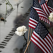 On the 15th anniversary of 9-11 at Ground Zero, flowers placed on the memorial plagues  by a loved ones by the name of a family member who died that day.<br /> <br /> The 2,983 names of the victims of the attacks of Sept. 11, 2001, and Feb. 26, 1993, World Trade Center truck bombing are inscribed into bronze parapets surrounding the twin memorial pools.