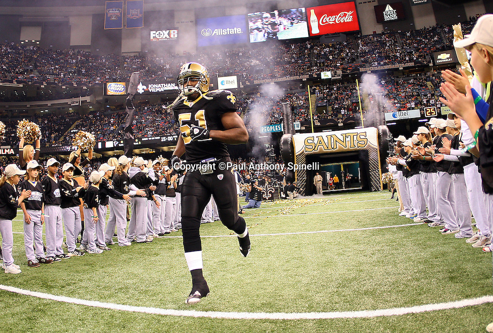NEW ORLEANS - DECEMBER 07: Linebacker Jonathan Vilma #51 of the New Orleans Saints runs onto the field during player introductions at the game against the Atlanta Falcons at the Louisiana Superdome on December 7, 2008 in New Orleans, Louisiana. The Saints defeated the Falcons 29-25. ©Paul Anthony Spinelli *** Local Caption *** Jonathan Vilma