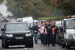 © Licensed to London News Pictures. 26/10/2017. Epsom, UK. A car swerves in the road to avoid a group of young men at the funeral of Tom 'Tomboy' Doherty the nephew of Big Fat Gypsy Weddings star Paddy Doherty, at Epsom Cemetery in Epsom, Surrey. Tom Doherty was 17 when he was killed in a car crash in South Nutfield in Surrey on October 9. He had passed his driving test just days earlier. Photo credit: Ben Cawthra/LNP