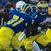 Delaware Quarterback JOE WALKER (3) hands the ball off to Delaware Running Back WES HILLS (31) during a week one game between the Delaware Blue Hens and the Delaware State Hornets, Thursday, Sept. 01, 2016 at Tubby Raymond Field at Delaware Stadium in Newark, DE.