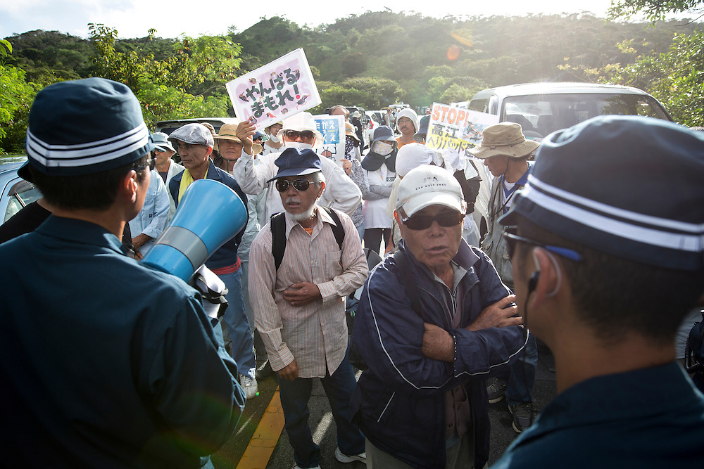OKINAWA, JAPAN - SEPTEMBER 14 : Anti U.S base protesters confront with police as they stand to stop the construction of helipads near the gate of U.S. military's Northern Training Area in the village of Higashi, Takae, Okinawa Prefecture, Japan on September 14, 2016. The Japanese government is allowing the use of its own Japan Air Self-Defense Force military helicopters Boeing CH-47 to get construction heavy equipments past the protesters on Tuesday, September 13 in order to speed up completion of six new helipads to be use by U.S Military.  (Photo by Richard Atrero de Guzman/NURPhoto)