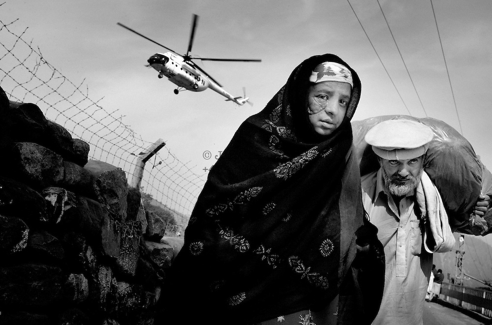 A young woman and her father returning to Muzzafrabad after being hospitalized in Islamabad for a month due to her severe headinjuries.<br /> Muzzafrabad, Kashmir - nov. 7 -2005