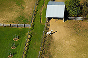 Aerial view of horse and barn on farm in the midwest.