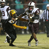 New Albany's Bryson Prather pushes away from Ripley's Landis Penro during Friday night's game at Ripley.