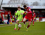 Crawley Town Defender Sonny Bradley (6) battles for the ball from Hartlepool United striker Luke James (33) during the Sky Bet League 2 match between Crawley Town and Hartlepool United at the Checkatrade.com Stadium, Crawley, England on 19 March 2016. Photo by Jon Bromley.