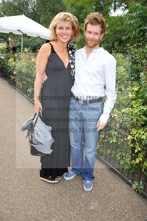 TOM & AMBER AIKENS at the unveiling of 'Isis' a sculpture by Simon Gudgeon hosted by the Royal Parks Foundation and the Halcyon Gallery by the banks of The Serpentine, Hyde Park, London on 7th September 2009.