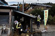 Iitate, Fukushima prefecture, November 12 2013 - Decontamination workers of Taisei company and its subcontractors at work, decontaminating a house.