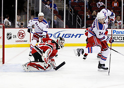 Oct 5, 2009; Newark, NJ, USA; New Jersey Devils goalie Martin Brodeur (30) makes a save on a tip by New York Rangers right wing Ryan Callahan (24) during the first period at the Prudential Center.