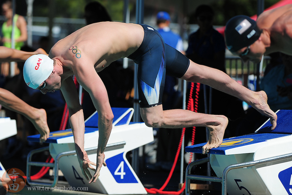 May 31, 2012; Santa Clara, CA, USA; Ryan Cochrane (CAN) dives off the starting blocks during the men's 800-meter freestyle in the Santa Clara international grand prix at the George F. Haines International Swim Center.