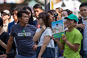 Supporters listen as Tokyo Governor, Yuriko Koike campaigns in support of candidates from her newly established Tomin First no Kai (Tokyoites First) party, in Shinjuku, Tokyo, Japan. Friday June 23rd 2017. The electioneering officially began on Friday with the popular female Governor's party fielding around 40, mostly young candidates hoping to lessen the power of the ruling Liberal Democratic Party (LDP) in the capital.