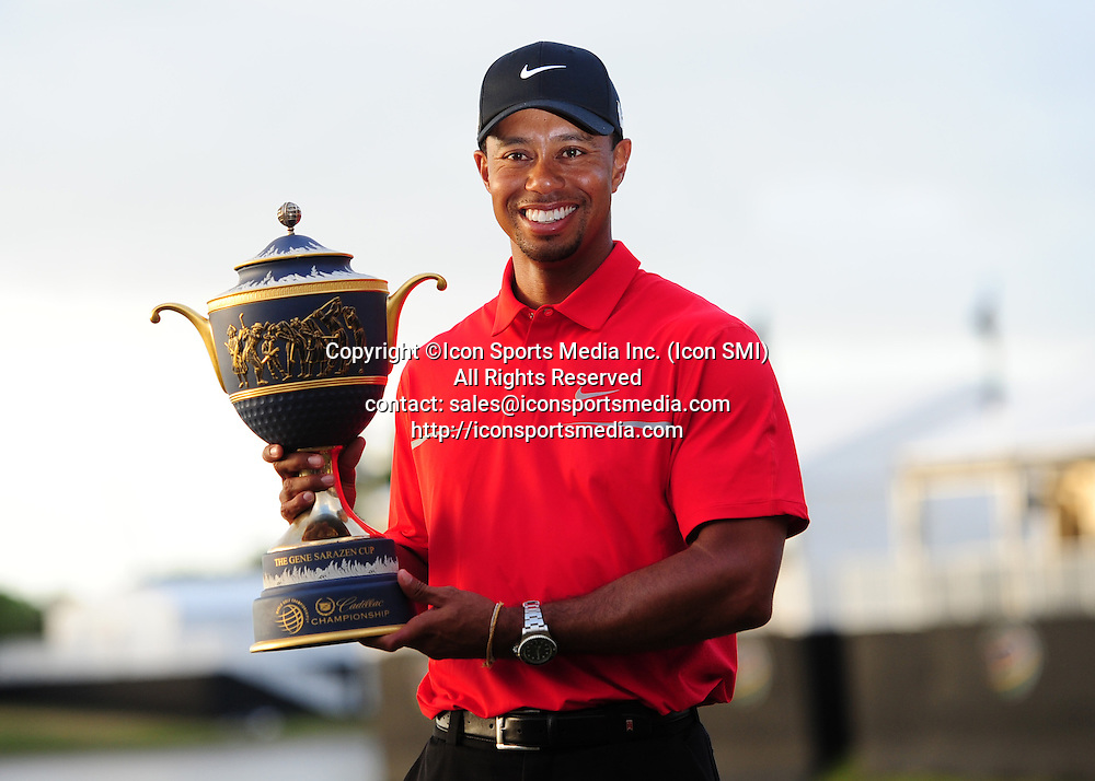March 10, 2013:    Tiger Woods holds the Championship trophy after winning the  WGC-Cadillac Championship final round at Trump Doral-Blue Monster Course, in Doral Florida