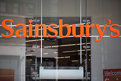 © Licensed to London News Pictures. 08/06/2016. Leeds UK. File picture taken 11/07/2015 shows Sainsbury's supermarket on the Headrow in Leeds. Sainsbury's has posted a fall in sales, Britain's second biggest supermarket reported a 0.8 % drop in like for like sales excluding fuel for the 12 weeks to June. The fall marks a setback after a return to quarterly like-for-like growth for the first time in more than two years the previous three months, when sales edged 0.1% higher.<br /> Photo credit: Andrew McCaren/LNP