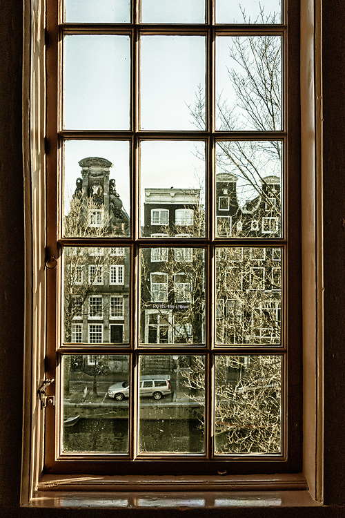 "The view across Amsterdam's  Oudezijds Voorburgwal from the hidden Catholic church, ""Ons' Lieve Heer op Solder"". the church is now a museum."