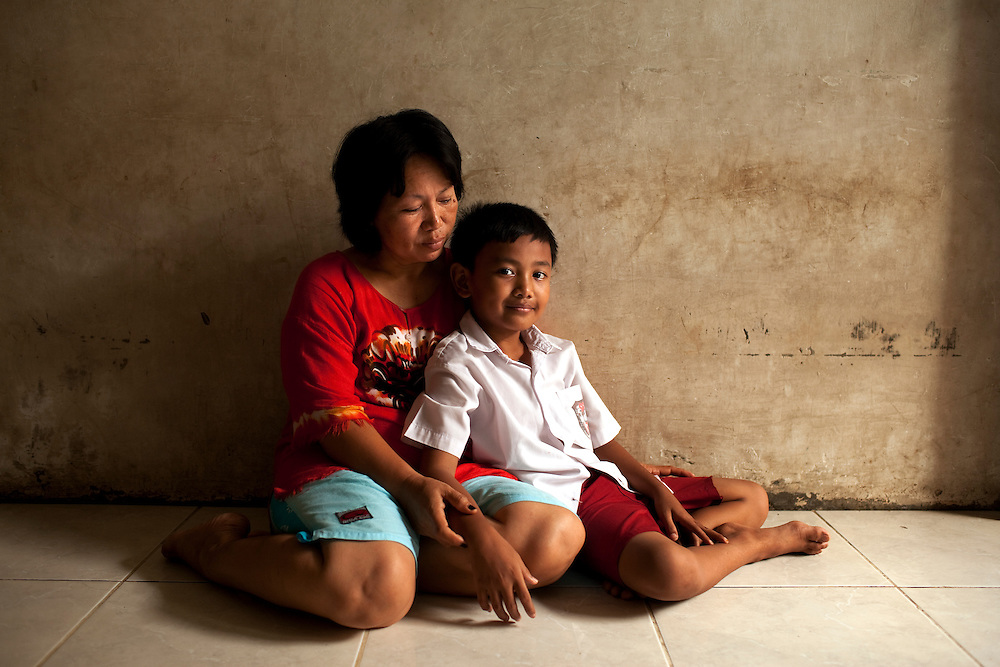 CASE. Nigel with his mother. When Nigel was 2 he was diagnosed with leukemia. His parents borrowed money everywhere to pay for his treatment. 2 months into the treatment they found out the provincial government would pay half if they proved they were poor. Later a foundation paid the other half. Nigel is now healthy. Jakarta, Indonesia.