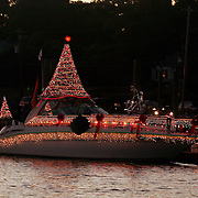Before nightfall, boats gather in the ICW in Wrightsville Beach as the North Carolina Holiday Flotilla prepares to get underway...Photo by Logan Mock-Bunting