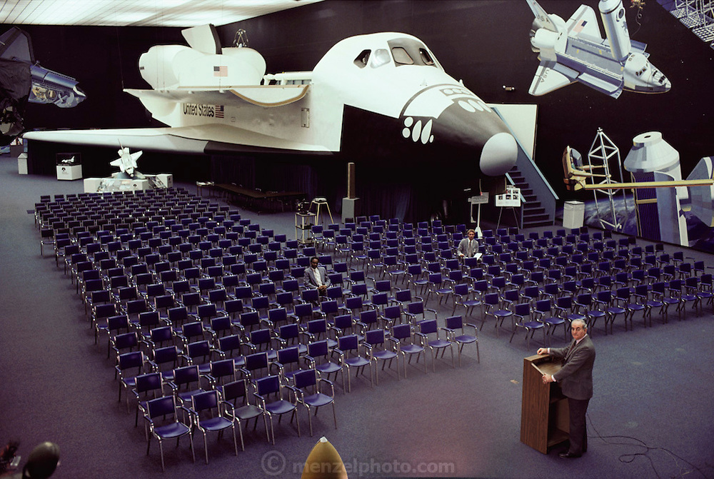 Rockwell Aerospace: manufacturer of airplane and space vehicles. Rockwell operated in Downey, California for seventy years (1929-1999) and produced systems for the Apollo Project as well as the space shuttle. President Rocco Petrone 1986, with full-scale mock-up of space shuttle.